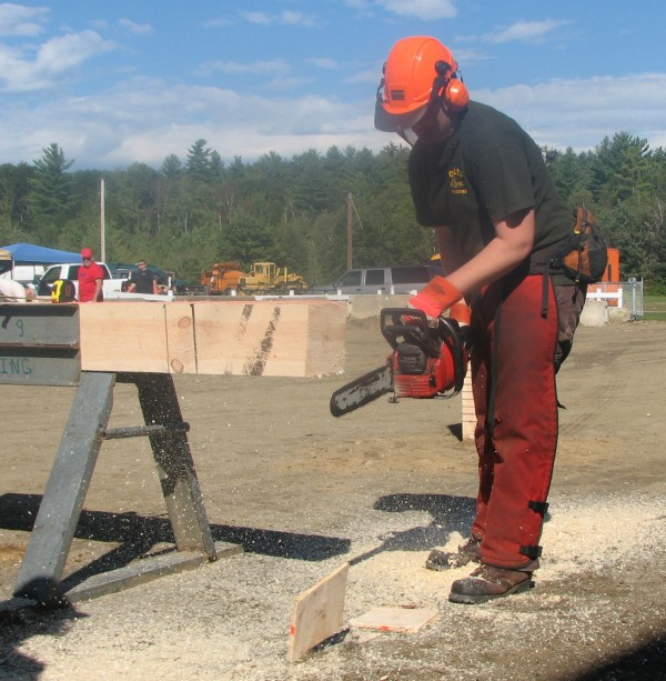 Oxford Hills Technical School student Deagan O'Neil competes in the chain saw event during Woodsmen's Day at the Oxford Fair on Monday morning.