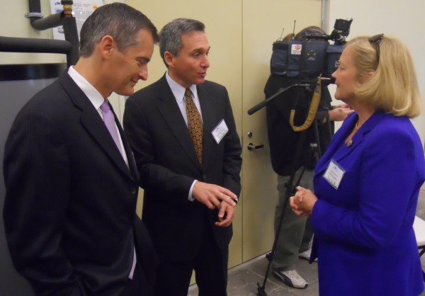 Southern Maine Community College President Ronald Cantor (center) talks to U.S. Rep. Chellie Pingree (right) and former Maine House Speaker Glenn Cummings at the opening celebration for the school's Sustainability and Energy Alternatives Center in South Portland on Thursday morning.