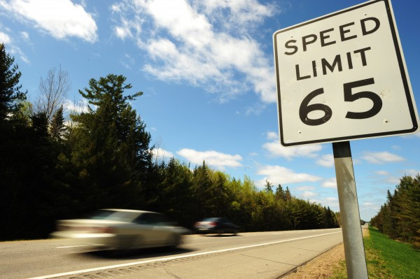 Cars on Interstate 95 zoom past a speed limit sign just north of Old Town. The speed limit on the stretch of road North of Old Town will soon be raised to 75 mph.