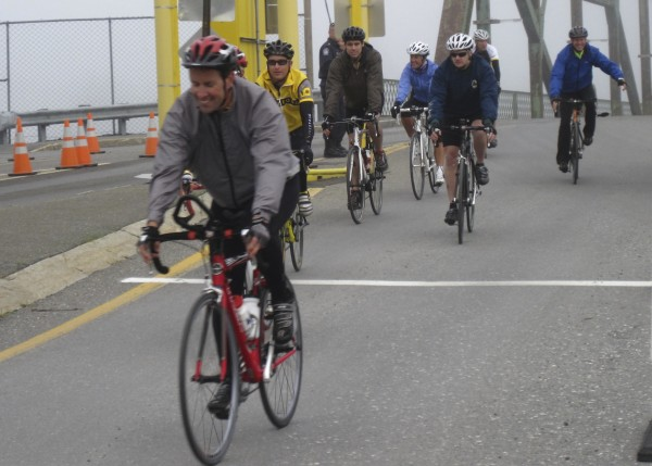 Cyclists with Spokes for Hope roll across the international bridge in Fort Kent  at the start of their 400 mile bicycle ride ending Monday in Kittery. The  cyclists are riding to raise funds and promote awareness of cancer support and  research.