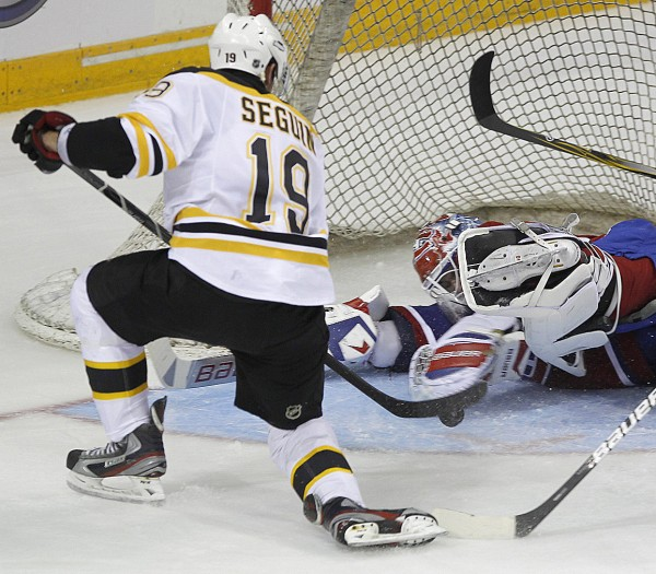 Tyler Seguin of the Boston Bruins tries to get a rebound past Montreal goaltender Peter Budaj during Sunday's NHL preseason game in Halifax, Nova Scotia. The Bruins are preparing to open defense of their Stanley Cup.
