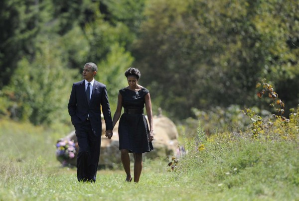 President Barack Obama and first lady Michelle Obama walk away after visiting the crash site of Flight 93 during their visit to the Flight 93 National Memorial Sunday, Sept., 11, 2011, in Shanksville, Pa., on the 10th anniversary of Sept. 11. Michelle Obama is due in Maine this week to raise funds for Democratic candidates.