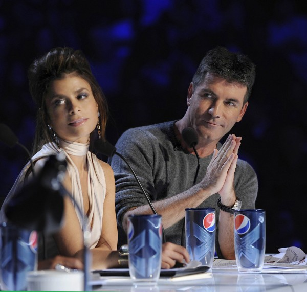 In this undated image released by FOX, judges Simon Cowell, right, and Paula Abdul are shown during auditions for the singing competition series &quotThe X Factor.&quot
