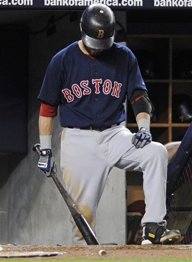 Boston Red Sox's Dustin Pedroia waits in the dugout during the ninth inning against the New York Yankees on Saturday, Sept. 24, 2011 at Yankee Stadium in New York. The Yankees won 9-1.