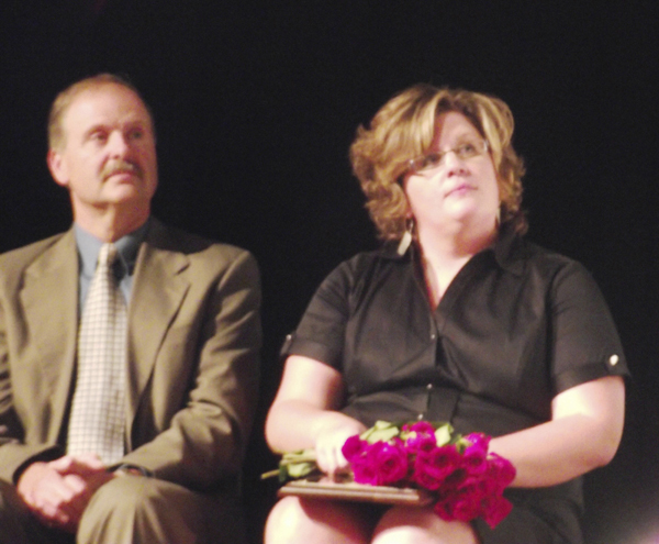 Alana Margeson (right), a grade 10-11 English teacher at Caribou High School, was named Maine's 2012 Teacher of the Year during a surprise ceremony at the school on Thursday, Sept. 15, 2011. At left is Frank McElwain, the superintendent of RSU 39 in Caribou