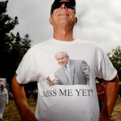Stan Pappas wears a shirt featuring former President George W. Bush at the Tea Party Express tour kick-off on Saturday, Aug. 27, 2011, in Napa, Calif. The Tea Party Express kicked off its fifth annual national tour with a rally in California's wine country before heading east through 19 states.  (AP Photo/Noah Berger)