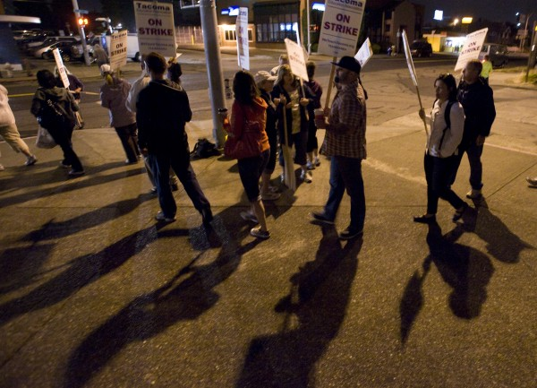 Teachers walk the picket line outside Lincoln High School just after 6 a.m. Tuesday, Sept. 13, 2011, in Tacoma, Wash. Eighty-seven percent of the Tacoma Education Association's total membership voted Monday evening to walk out, after weekend contract negotiations failed to result in an agreement, union spokesman Rich Wood said.