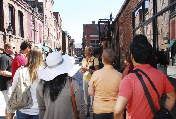 Ginger Lawson of Falmouth leads a Maine Foodie Tour through Portland''s Old Port in June, detailing some of the fancy restaurants on Wharf Street