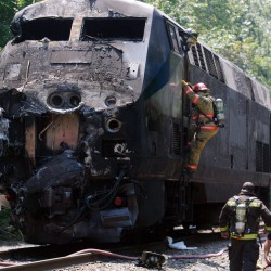 Driver in Amtrak crash was talking on phone and speeding, police say