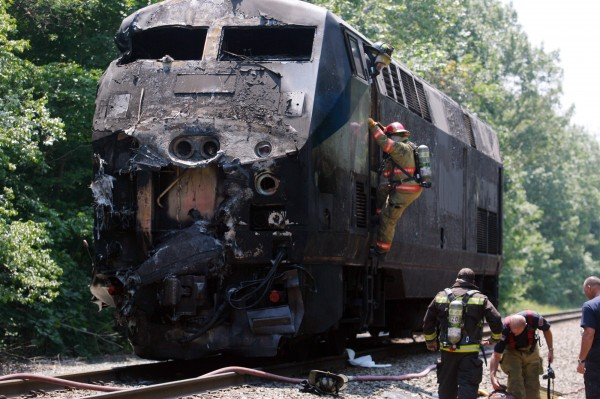 Firefighters work at the scene of an Amtrak passenger train that collided with a tractor-trailer in July 2011, in North Berwick.