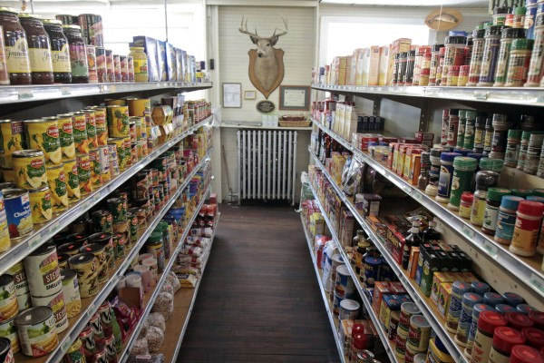 This Sept. 14, 2011 photo shows a deer head mounted at the end of a shopping aisle at the Hastings Store in West Danville, Vt.