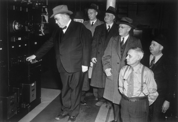 Edward M. Graham (left) turns of the electric power to the generator on Dec. 31, 1945, at the Bangor Hydro-Electric substation at the top of Park Street hill. With him on the citys last day of trolley service are (from left) Charles H. Johnson, superintendent of transportation; Gordon D. Briggs, attorney; Ernest W. Brown, operating engineer; Frank G. Usher, utility man; and Millard F. Brown, operator.