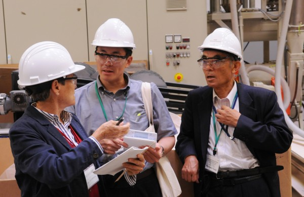 Maine Housing Director Dale McCormick (from left) helps Aomori prefecture government senior staff member Yasunori Kitagawa and Hirosaki University assistant to the president Dr. Hirotada Nanjo understand an English term as they tour the Advanced Structures and Composites Center on the University of Maine campus in Orono on Thursday, Sept. 8, 2011.