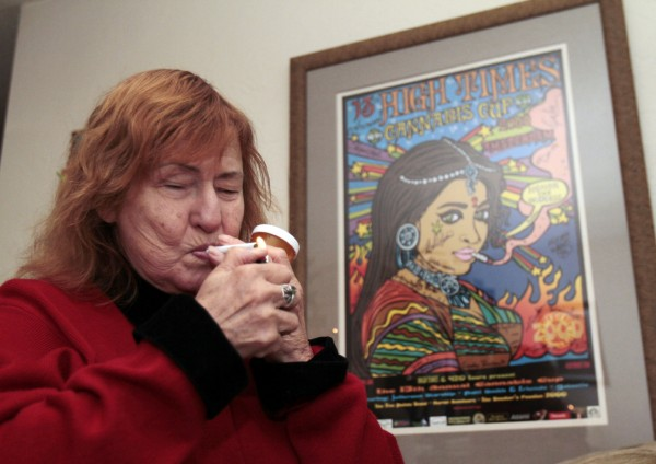 Elvy Musikka, 72, who suffers from glaucoma, lights a marijuana cigarette, one of many she regularly receives from the U.S. Government, at her home in Eugene, Ore., Tuesday, Sept. 27, 2011.