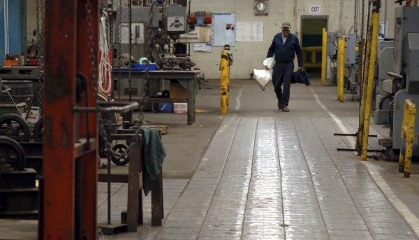 A worker leaves his shift at Katahdin Paper Co. in 2008, shortly after the company announced it would be closing the mill. A plan by a New Hampshire investor to buy the mills will close by Friday, an investor told the Bangor Daily News on Thursday.