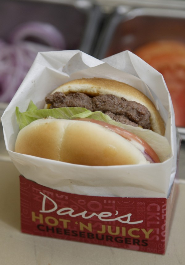 In this Sept. 15, 2011 photo, a new Dave's Hot 'N Juicy Cheeseburger is displayed in the Wendy's research and development laboratory at the company's international headquarters in Dublin, Ohio.