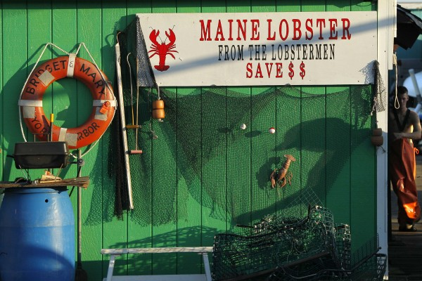 A sign advertises lobster on fisherman Doug Cressey's building on Widgery Wharf in Portland.