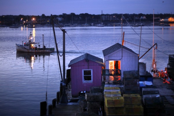 Lobsterman Gregg Whitten leaves Portland's  Widgery Wharf at dawn.