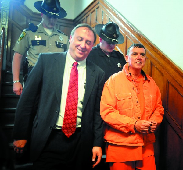 Rep. Fred Wintle, R-Garland (right) is escorted back to Kennebec County jail in May, 2011, by House Republicans Chief of Staff Earl Bierman (left), following Wintle's Harnish hearing at Kennebec County Superior Court in Augusta. Wintle has resigned from his House seat less than four months after he was arrested for allegedly pointing a loaded handgun at a man in Waterville.