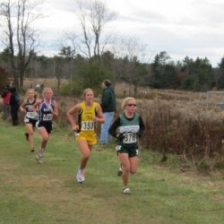 Old Town's Dacie Manion leads Maranacook's Abby Mace and John Bapst's Adrienne Carmack in the 2010 Class B state cross country race in Belfast.
