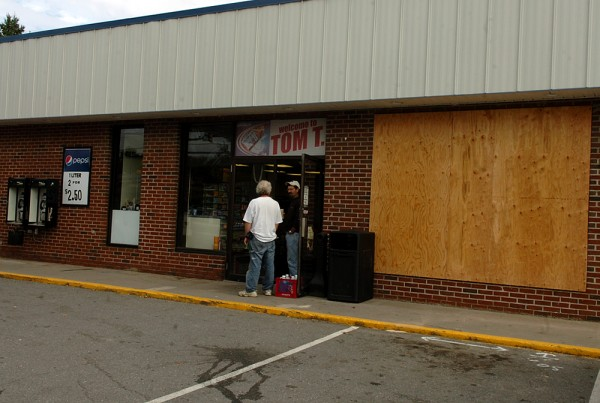 With plywood covering a shattered window, Tom T's Irving on Ohio Street was one of two Bangor businesses hit by vandals overnight Wednesday. Police received approximately 30 criminal mischief complaints as of mid-morning on Thursday, many involving similiar vandalism.