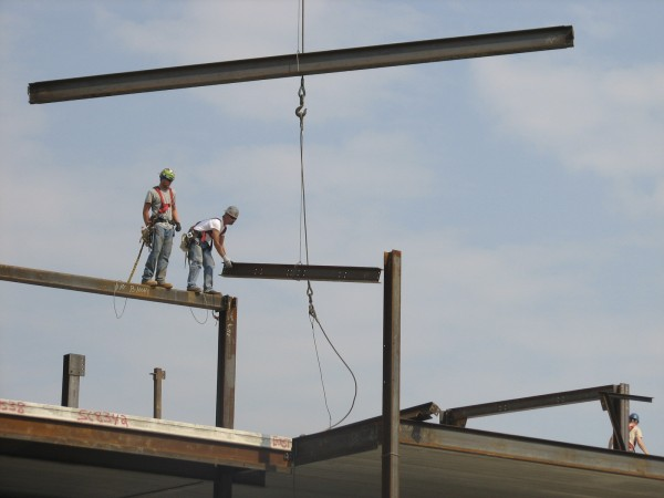 Steelworkers with Brewer-based Arc Erecting set beams into place Wednesday, Sept. 14, 2011, on a 102-room Ocean Properties hotel under construction on West Street in Bar Harbor. The workers and Ocean Properties officials held a &quottopping off&quot ceremony Wednesday to mark the placement of the last remaining piece of structural steel in the building, which is expected to be completed by June 2012.