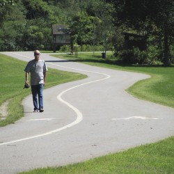 Bart Guckenburg of Brunswick enjoys a walk on the Androscoggin River Bicycle and Pedestrian Path in Brunswick on Tuesday, Aug. 30, 2011. Local officials are hoping to extend the heavily used path all the way to Bath.