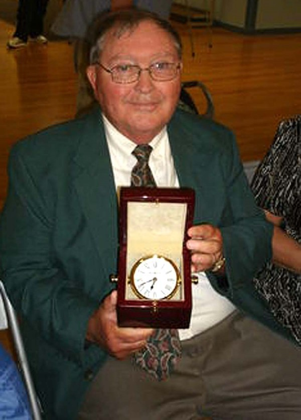 Longtime Brewer educator and business manager Lester Young, who was the owner's representative for the newly opened Brewer Community School, was named Citizen of the Year at this year's Brewer Days. Gold Star Cleaners was named the Business of the Year.