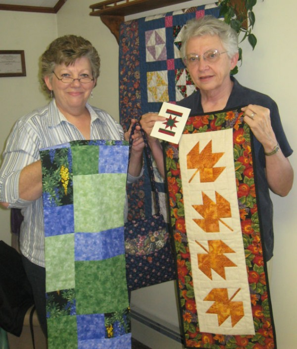 Norma Quimby and Pat Pierson show some of the items to be made in the classes during Waldo County Handcrafters' Day Saturday, Oct. 1, at the Waldo Community Building.
