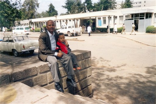 In this 2002 photo provided by the family, Wondu Bekele sits with his son Mathiwos outside the the Black Lion Hospital in Addis Ababa, Ethiopia. He died eight months later because of cancer in September 2003 at the age of four. The desperate father had called St. Jude Children's Research Hospital in the United States for advice, procured chemotherapy drugs from India, and against all odds, got his son treated for leukemia. Yet the little boy died because the hospital had no separate ward to keep vulnerable cancer patients from catching other patients' diseases. The father founded a cancer society in his son's name. The U.N. General Assembly in Sept. 2011 will hold its first summit on chronic diseases - cancer, diabetes and heart and lung disease. Those account for nearly two-thirds of deaths worldwide and nearly 9 out of 10 in the United States. They have common risk factors, such as smoking and sedentary lifestyles, and many are preventable.