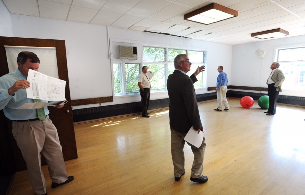 The Penobscot County commissioners tour the former YMCA building Tuesday on Hammond Street in Bangor.