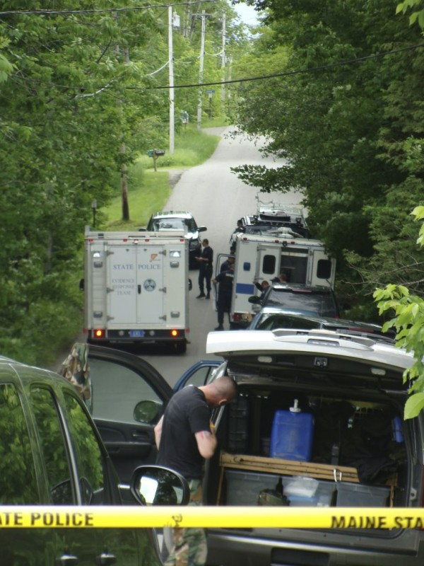 Police cordon off the Shore Road in Dexter in June 2011 after finding four bodies in a house where shots were heard fired earlier in the morning. The bodies were identified as Steven Lake, his estranged wife, Amy Lake, and the couple's two children, Coty and Monica.