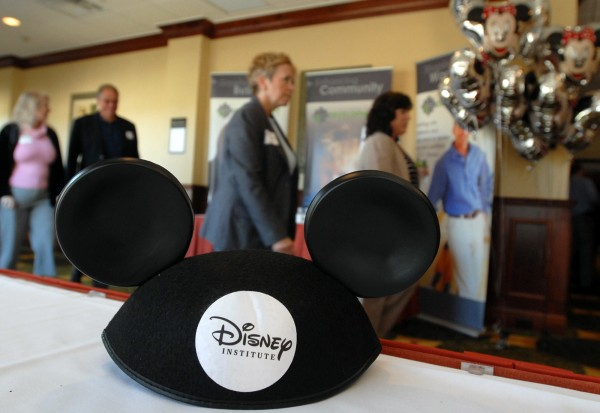 Guests attending the Disney's Approach to Business Excellence Seminar file into the grand ballroom of the Hilton Garden Inn in Bangor on Tuesday, Sept. 27. The day-long seminar was put on by the Eastern Maine Development Corporation.
