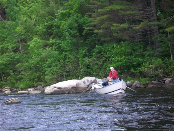 Anglers fish out of a drift boat on the West Branch of the Penobscot River in June.