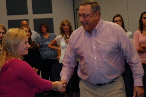 Gov. Paul LePage took a few moments to meet the students like Chelsea Minson of Winterville, who are participating in the Pleasant Street Academy at the University of Maine at Fort Kent. The pilot program allows high school juniors to take university courses toward both a university degree and their high school core requirements.
