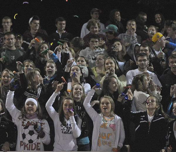 Ellsworth High School students and fans celebrate as the clock runs out and coach Brian Higgins gets his 500th win in their game against Hermon in Ellsworth Wednesday. Ellsworth won 7-0.