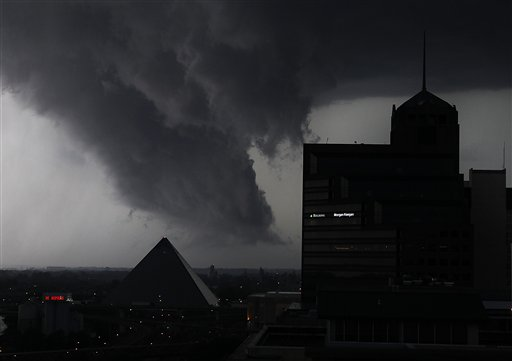 A line of severe storms crosses the Mississippi River in Memphis, Tenn., passing by the Memphis Pyramid, last May.