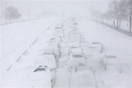Hundreds of cars sit stranded on Lake Shore Drive in Chicago during a winter blizzard in February. There have been more than 700 U.S. disaster and weather deaths in the US this year.