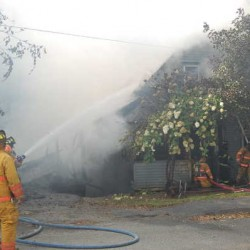 Teen hears smoke detector, alerts families to fire that destroys home