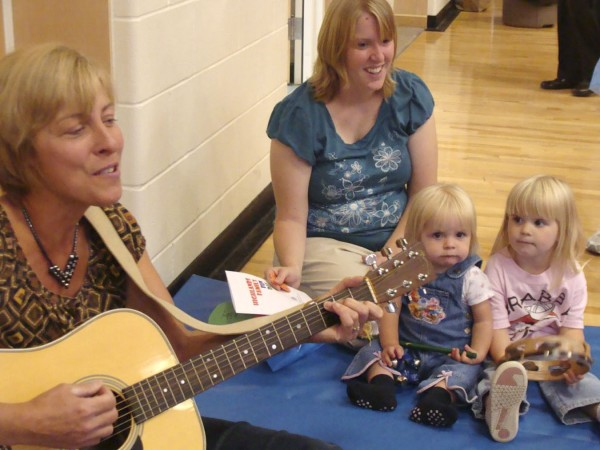 Jessica Roy of Wellington watched as her two daughters McKenzie Roy, 18 months, and Abigail Ray, 3, played musical instruments with SAD 46 teacher Deborah Roderka of Dexter at the Highlands Family Fun Day held Saturday at Ridge View Community School in Dexter.