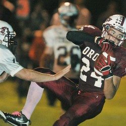 Orono's Tyler Higgins (24) comes down in the end zone with the ball on a pass reception in the second quarter against Foxcroft Academy in Orono Friday night, Sept. 30, 2011.