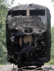The charred engine of the Amtrak train that collided into a tractor-trailer is seen Monday, July 11 in North Berwick, Maine.