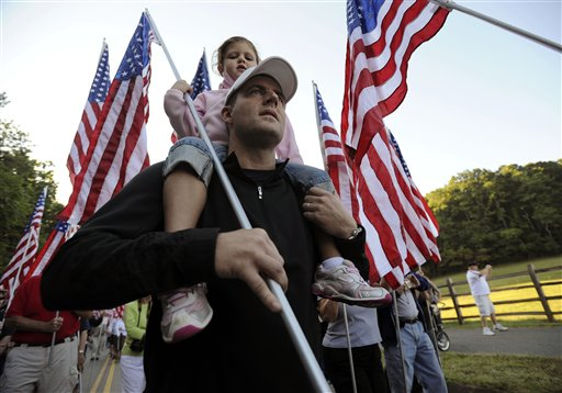 Paige and Mark Oliver walk with flags from Grace Community Church in Kennesaw, Ga., to Kennesaw Mountain National Battlefield Park to help commemorate the 10th anniversary of the Sept. 11 attacks.
