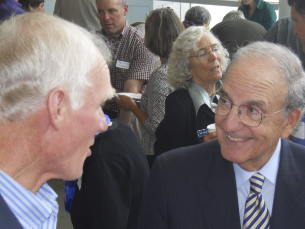"Former U.S. senator George Mitchell mingles with longtime friend and former Natural Resources Council of Maine Executive Director Everett ""Brownie"" Carson Friday before Mitchell's keynote speech at the NRCM's annual membership meeting."