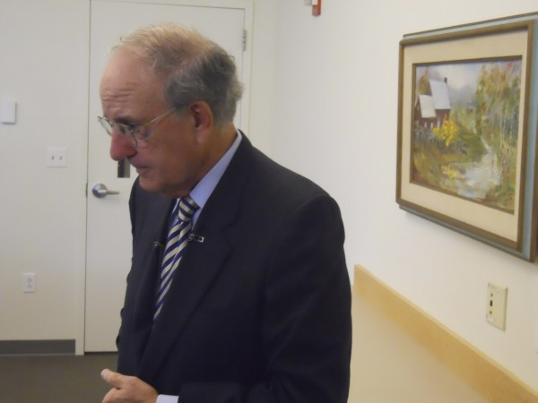 Former U.S. Sen. George Mitchell prepares to answer questions from reporters Friday at a press conference after his keynote speech at the Natural Resources Council of Maine's annual membership meeting.