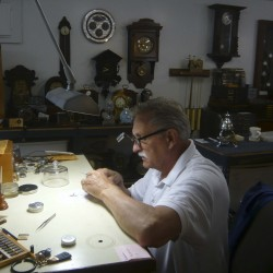 Watch repairman Errol Stewart examines the inner workings of an antique timepiece. Stewart and his wife, Michelle, have reopened the Watch Repair Center at Knox Mill in Camden in the aftermath of the original owner's death earlier this year.
