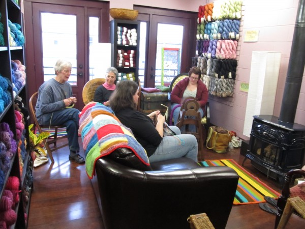 Ann MacMichael (from left), Sherri Vigue, Mary Kate Povak and Khristina Thayer knit inside Happyknits, a store inside the former visitors center at the old Somerset County Jail in Skowhegan.