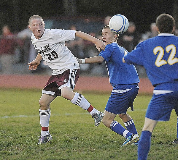 Ellsworth's Jake Hale (20) deflects the ball toward the net Wednesday past Hermon's Jacob Rioux (4) in the first half of their game in Ellsworth.
