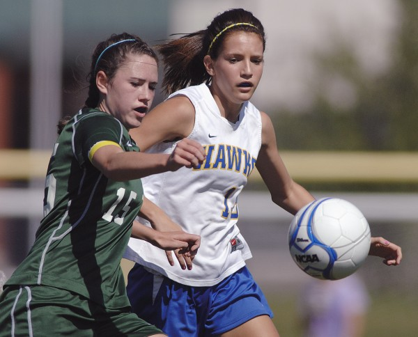 Old Town's Kelsey Maxim (15) battles with Hermon's Mollie Roy (15) for the ball near midfield during the first half of their game in Hermon Saturday, Sept. 17, 2011.