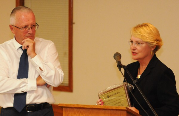 Dennis Marble (left) director of the Bangor Area Homeless Shelter listens as Bangor Daily News marketing director Elizabeth Hansen (right) offers a few words after accepting the Organizational Volunteer of the Year award on behalf of Publisher Richard J. Warren on Tuesday, Sept. 20, 2011, at the Eagles Club in Brewer.